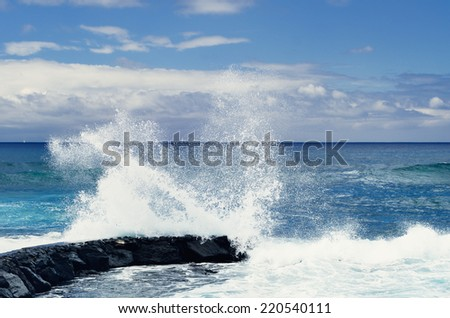 Tall waves crashing on the coastline of the ocean - stock photo