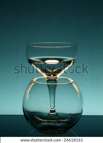 Tall wineglass and a flower bowl against a color background - stock photo