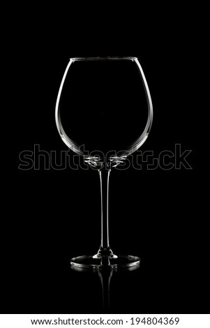 tall wineglass , vertical photo on black background - stock photo
