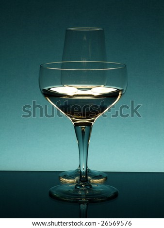 Tall wineglasses against a color background