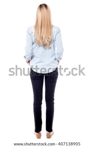 Tall woman facing away, white background.