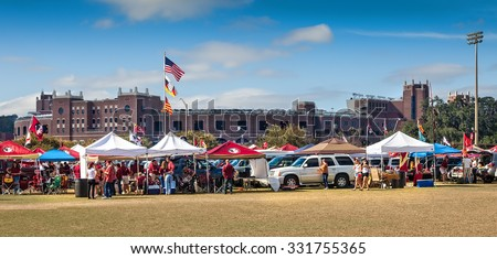 TALLAHASSEE, FL - NOV. 16, 2013:  FSU fans tailgating outside Doak Campbell Stadium before a home game against Syracuse University.  Tailgating in the open parking lots owned by the Booster Club.