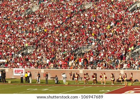 TALLAHASSEE, FL - OCT. 22:  Sold out crowd at Doak Campbell Stadium, home of the FSU Seminoles on Oct.22, 2011 in Tallahassee, FL. The football stadium can hold 82,300 fans, making it the fourteenth largest in the NCAA. - stock photo