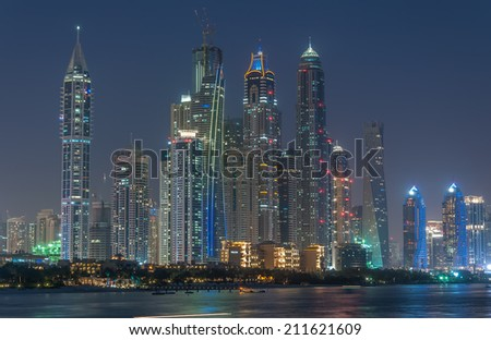 Tallest skyscrapers in the world of Dubai Marina at Blue hour, Glittering lights and tallest skyscrapers during a clear evening with Blue sky. - stock photo