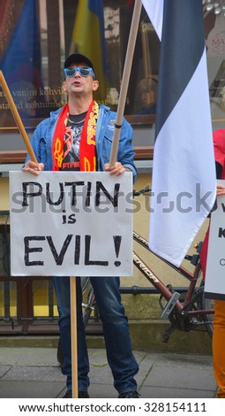 TALLINN ESTONIA 09 27 2015: Anti-Russian against V.Putin protest in connection with military aggression of Russia against Ukraine and flight MH317 Malaysian air line in front the Russian embassy. - stock photo