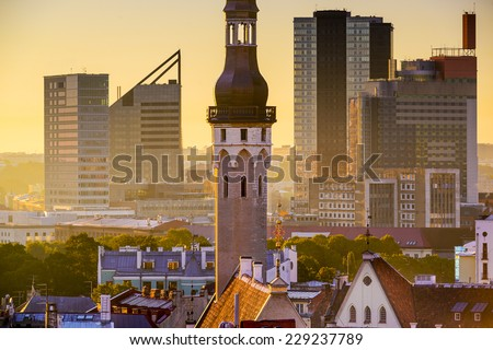 Tallinn, Estonia cityscape with old Town Hall spire and Modern high rises in the background. - stock photo