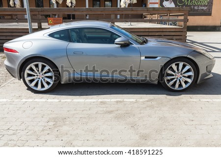 Tallinn, Estonia - May 2, 2016: Gray metallic Jaguar F-Type coupe, side view. Two-seat sports car, based on a platform of the XK convertible, manufactured by British manufacturer Jaguar Cars from 2013 - stock photo