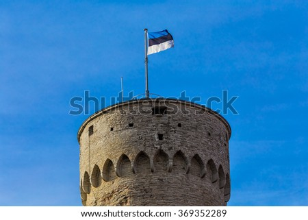 Tallinn, Estonia - The Estonian Flag on the Tower on the Toompea Hill - stock photo