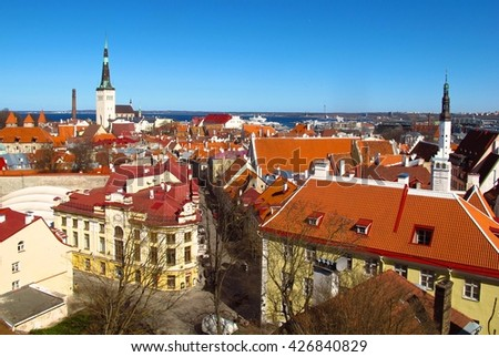 Tallinn Estonia Toompea Hill Castle Hill viewpoint overlooking church spires and red tiled rooftops toward harbor - stock photo