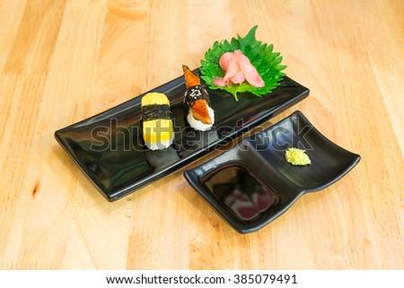 tamakoyaki or egg roll sushi and unagi or grilled eel sushi set - stock photo