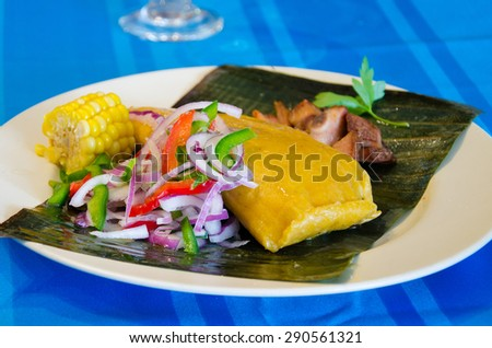 Tamal or Tamales, Traditional Cuban cuisine different ingredients in the white plate on the table - stock photo