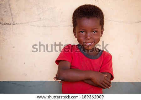 TAMALE, GHANA - MARCH 22: Unidentified young african boy  pose with smiling face on May 22, 2014 in Tamale, Ghana. Tamale is the hub of all commercial activity in Northern Region of Ghana.