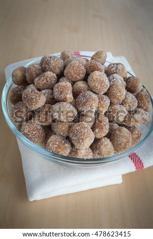 Tamarind candy in white bowl on wooden background, Candy made from tamarind
