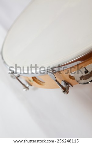 Tambourine in vertical position with nobody holding on  a white background - stock photo