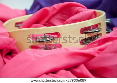 tambourine music instrument on pink - stock photo