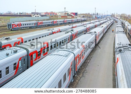Tambov, Russia - April 26, 2015: Branded cars on the Russian railway train station Tambov.  Siding with the compartment and second-class carriages . The quality of medium format - stock photo
