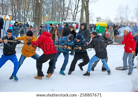 Tambov, Russia - February 15, 2015: Maslenitsa (pancake week, shrovetide) - carnival of farewell winter and meeting spring in Tambov.  Tug of War competition.  The quality of medium format