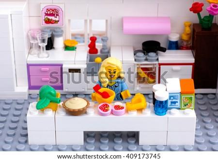 Tambov, Russian Federation - August 29, 2015 Lego domestic kitchen. Lego blonde woman cooking dessert. Custom set. Studio shot. - stock photo