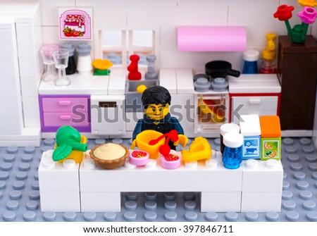 Tambov, Russian Federation - August 29, 2015 Lego domestic kitchen. Lego man cooking dessert. Custom set. Studio shot. - stock photo
