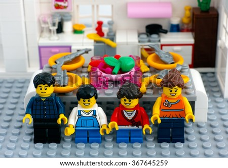 Tambov, Russian Federation - August 29, 2015 Lego family in domestic kitchen with table ready for dinner. Custom set. Studio shot. - stock photo
