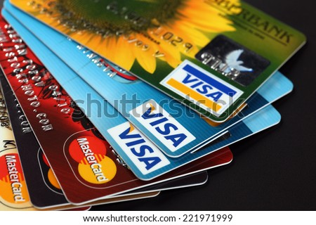 Tambov, Russian Federation - September 11, 2012: Heap of credit cards with Visa and Mastercard logos on black background. Studio shot.  - stock photo