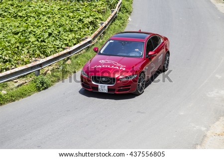 Tamdao, Vietnam - Jun 14, 2016: Jaguar XE 2016 car is at the test drive on mountain road in Vietnam.