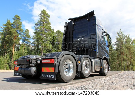 TAMMISAARI,FINLAND-JULY 20:Volvo FH16 600 truck parked in Tammisaari, Finland on July 20,2013.Volvo Trucks plans to commercialize dimethyl ether powered heavy duty commercial vehicles in N. America. - stock photo