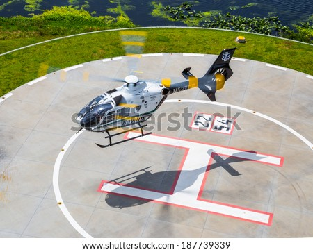 Tampa, Florida April 4th, 2014 Bayflte Trauma Rescue Helicopter lifts off of the landing pad to respond to and accident trauma scene in Tampa Florida. - stock photo