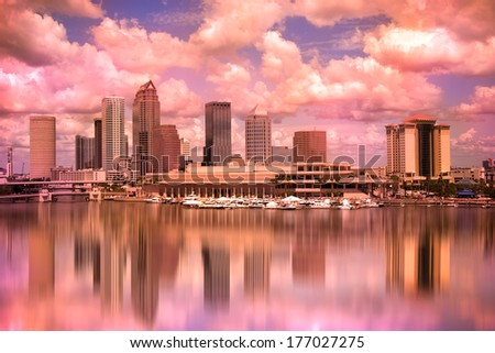 Tampa Florida skyline during colorful sunset - stock photo