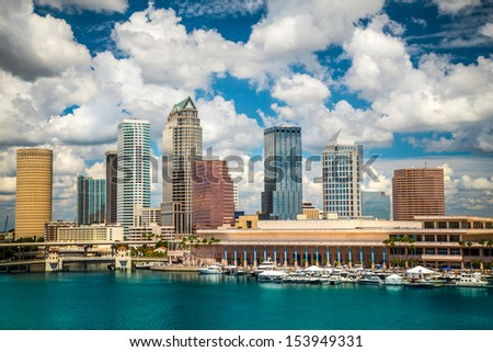 Tampa Florida skyline with sun and clouds - stock photo