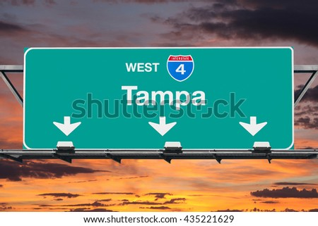 Tampa Interstate 4 west highway sign with sunrise sky. - stock photo
