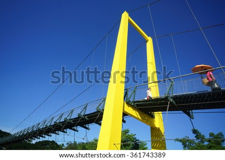 Tamparuli Sabah Malaysia - Jan 13, 2016 : People seen walking on Tamparuli suspansion bridge. The Tamparuli landmark bridge called Jambatan Tamparuli is themost famous suspansion bridge in Malaysia.