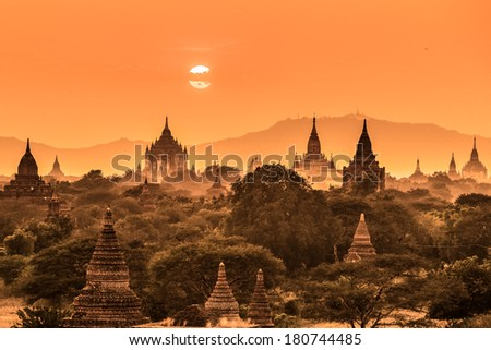 Tamples of Bagan, ancient city located in the Mandalay Region of Burma, Myanmar, Asia at down.  - stock photo