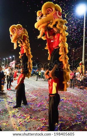 TAMSUI,TAIWAN - June 3 : The folk-custom acrobatics in the temple fair of township in night on June 3,2014 in Tamsui,Taipei,Taiwan. The fair held  annually on chinese lunar date of sixth in May.