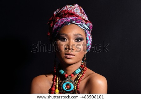 Tan African Asia Girl in Fashion Make Up with accessory in studio lighting as strong sunshine and shadow, copy space for text