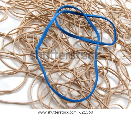 Tan and blue rubber bands - stock photo