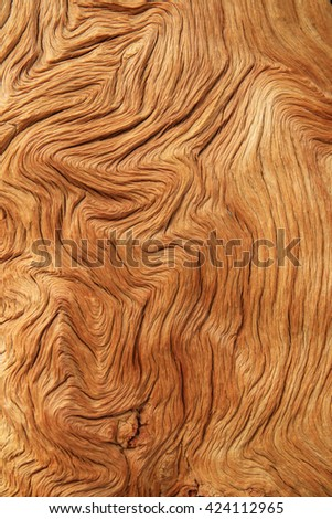 tan contorted and eroded woodgrain background texture - stock photo