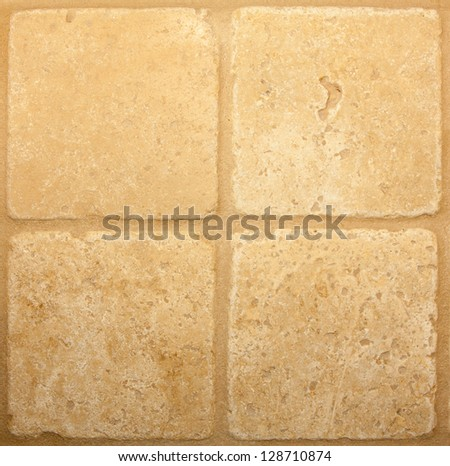 tan travertine tile pattern background with tan grout lines