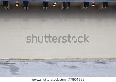 tan wall parking lot - stock photo