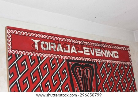 TANA TORAJA, INDONESIA - JULY 2 2012: Toraja Evening billboard at the entrance of an hotel