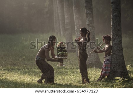 Tanah Embet village, West Lombok, Indonesia - April 23, 2017 : Handing over the hindu offering