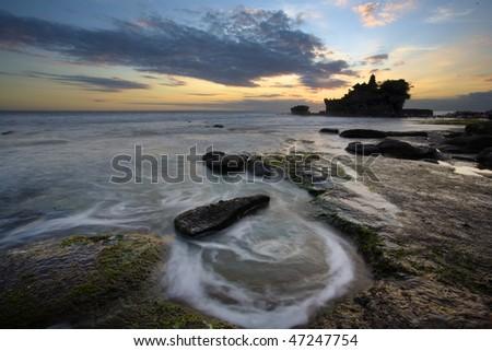 Tanah Lot Hindu temple sunset on Bali island Indonesia - stock photo