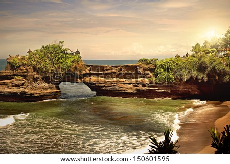 TANAH LOT, INDONESIA - 17 of February 2013: Tanah Lot is a rock formation off the Indonesian island of Bali. - stock photo