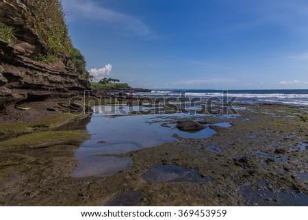 Tanah Lot rocks in Bali - stock photo