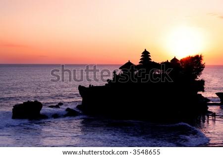 Tanah Lot Sunset ~ Hindu temple of Tanah Lot, off the coast of Bali, Indonesia, at sunset. - stock photo