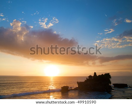 Tanah Lot Temple in Bali at sunset - stock photo