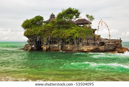 Tanah Lot temple (Pura Tanah Lot) over ocean at Bali, Indonesia - stock photo