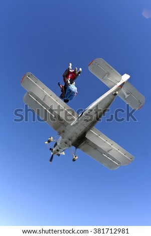Tandem jump. Jump out of a plane and fly back. - stock photo
