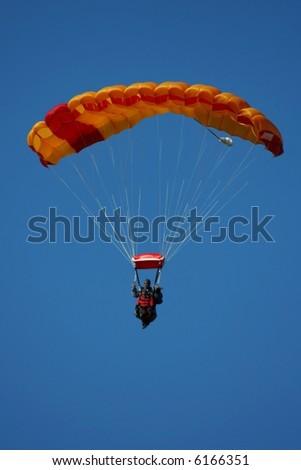 Tandem parachuting - stock photo