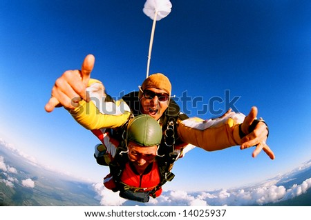 Tandem skydiver in action parachuting. - stock photo